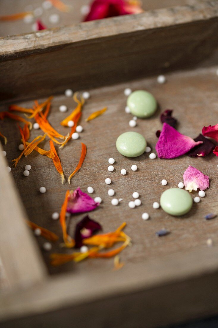 Globules and tablets with dried marigold, rose and lavender petals and flowers
