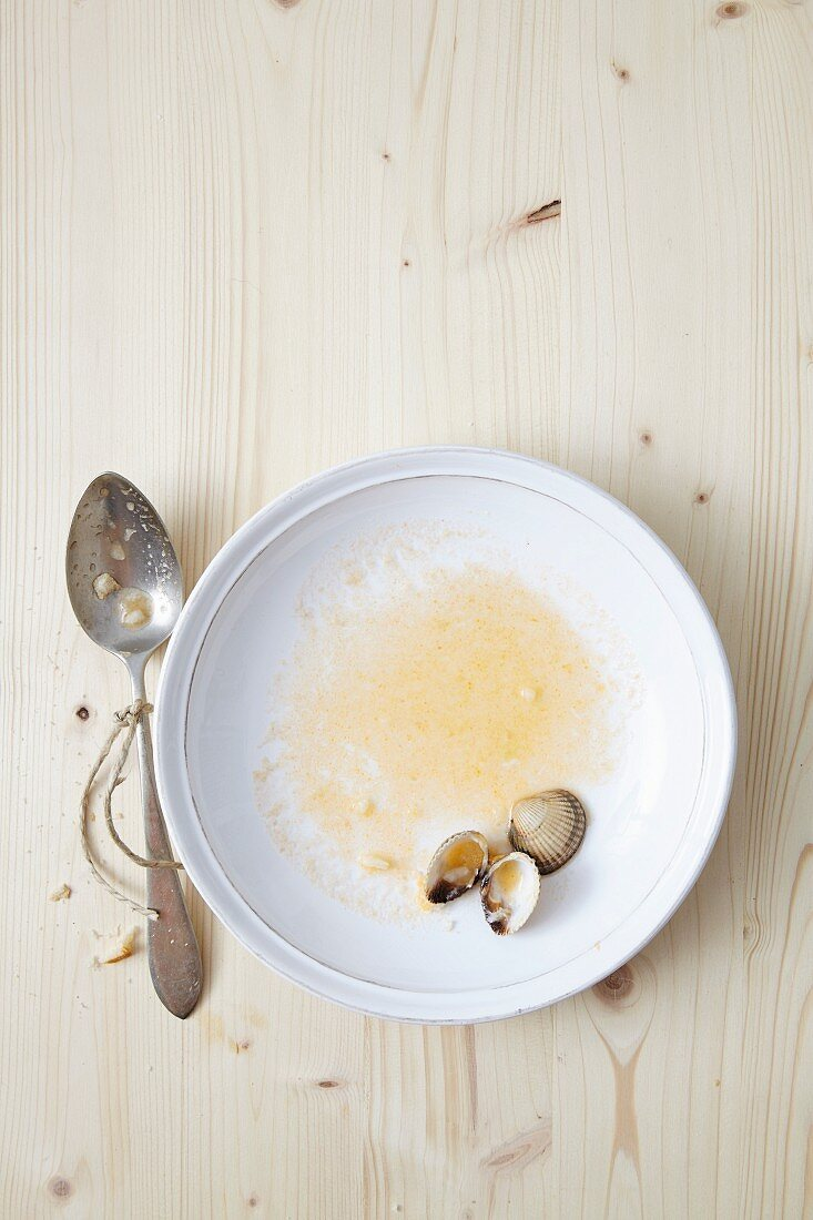 The remains of mussel soup in a bowl