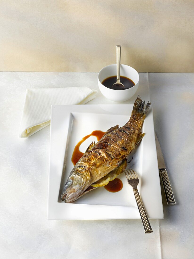 Grilled sea bass with soy sauce