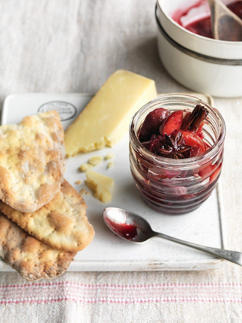 Spicy plum chutney served with hard cheese and unleavened bread