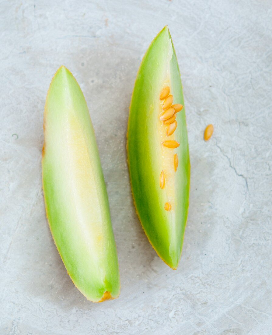 Two wedges of honeydew melon
