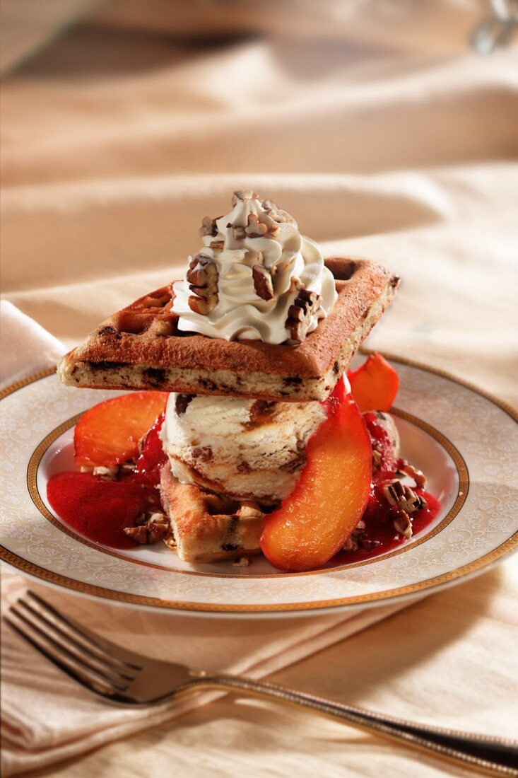 Ice cream dessert with waffles and peaches