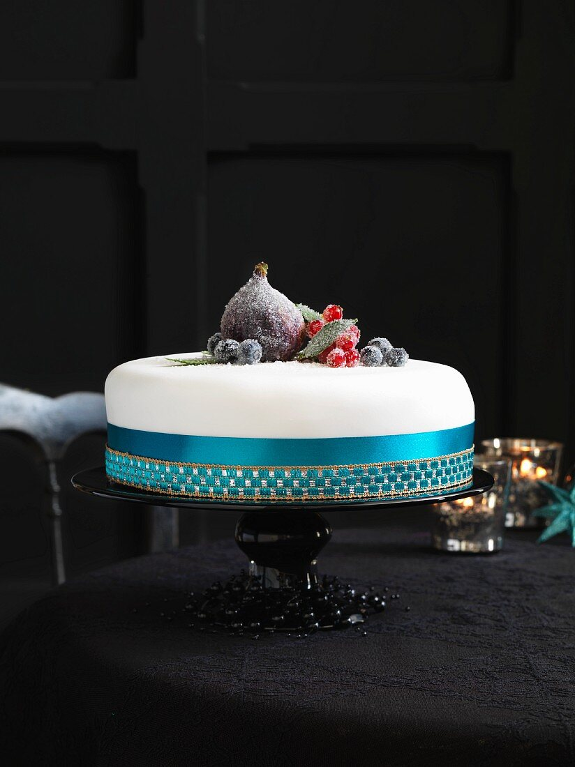 An elegant Christmas cake decorated with sugared fruits