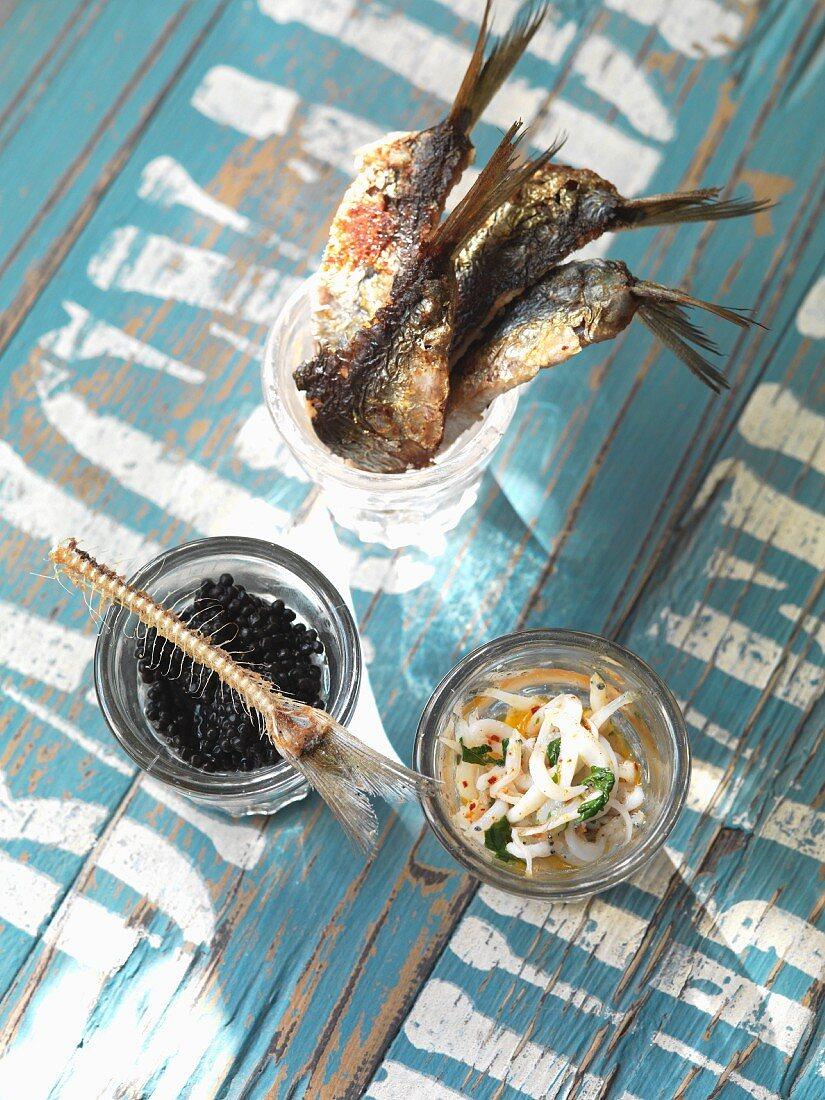 Sardine tapas with caviar and vegetables