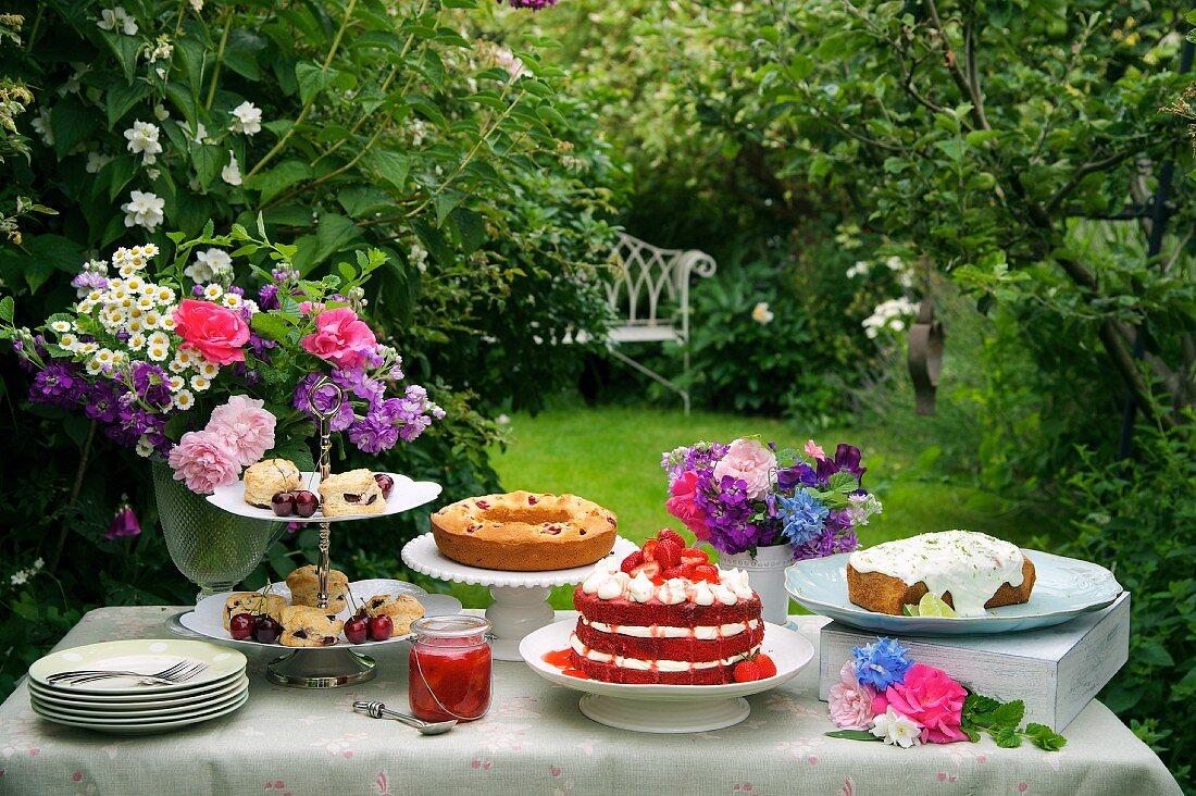 A cake buffet in a summer garden