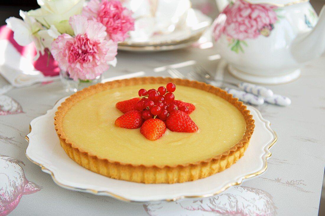 Yuzu tart with fresh berries