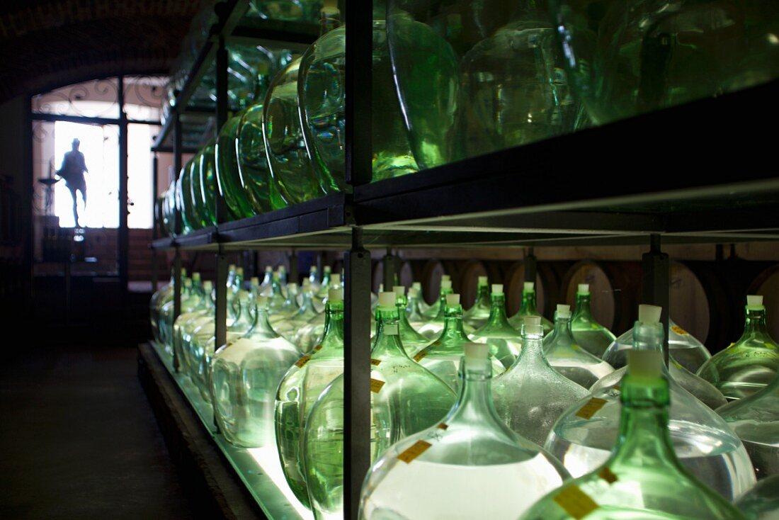 Bottles of vinegar on a shelf in a cellar