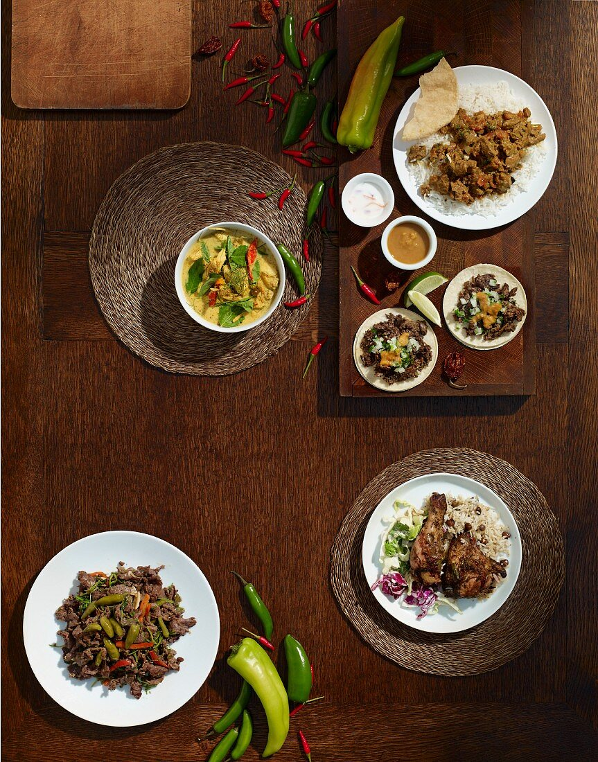 Dishes from various countries: lamb curry, halibut cheeks, carne asada, turnips with pickled pepperonis and jerk chicken