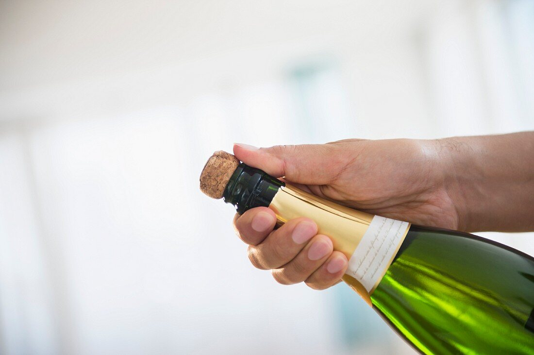 A bottle of champagne being opened