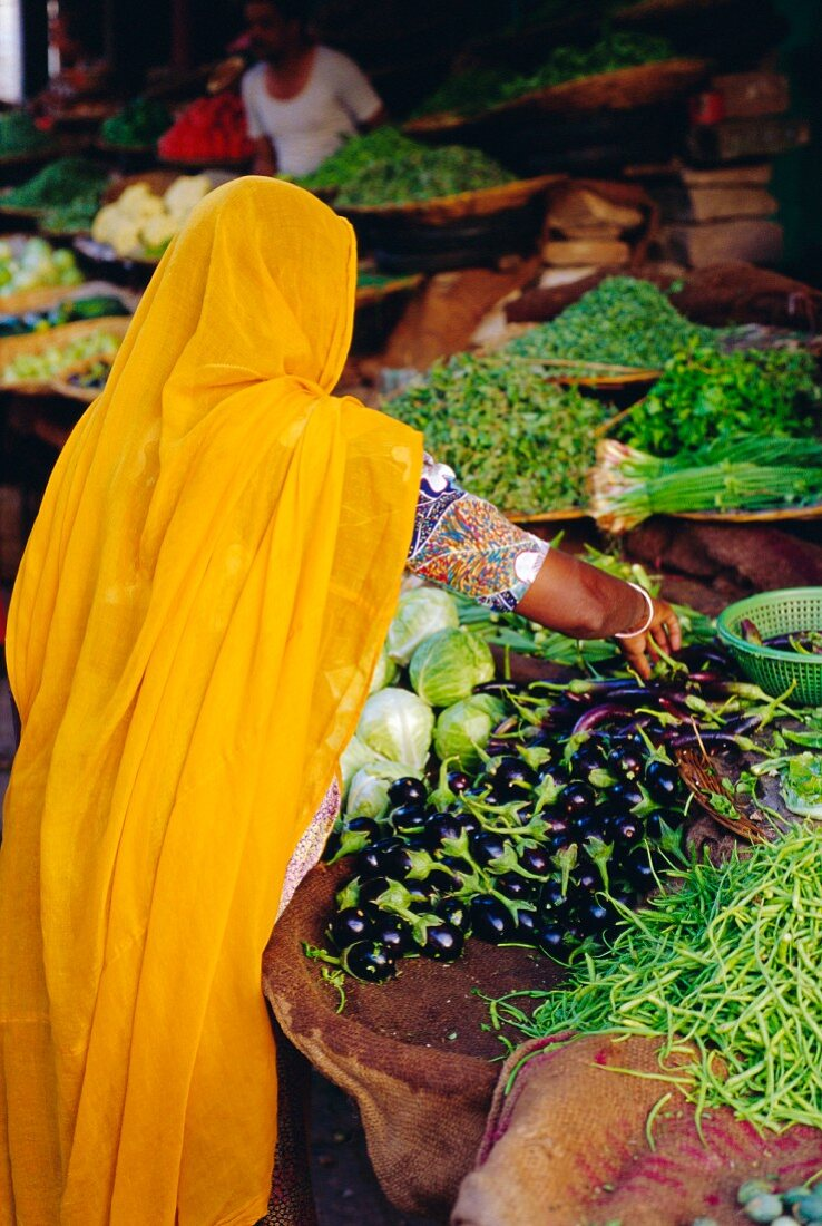 A woman buying vegetables at a market in Jodphur, Rajasthan, India