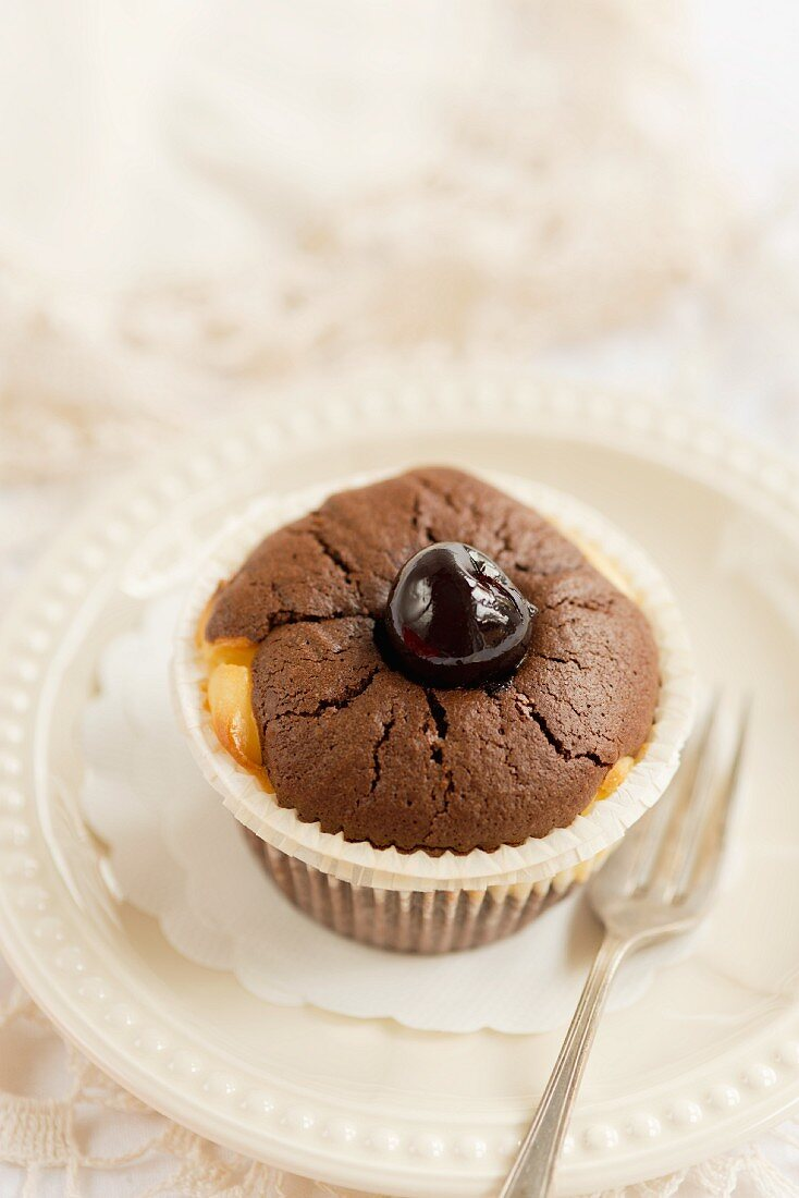 A brownie muffin with cherries