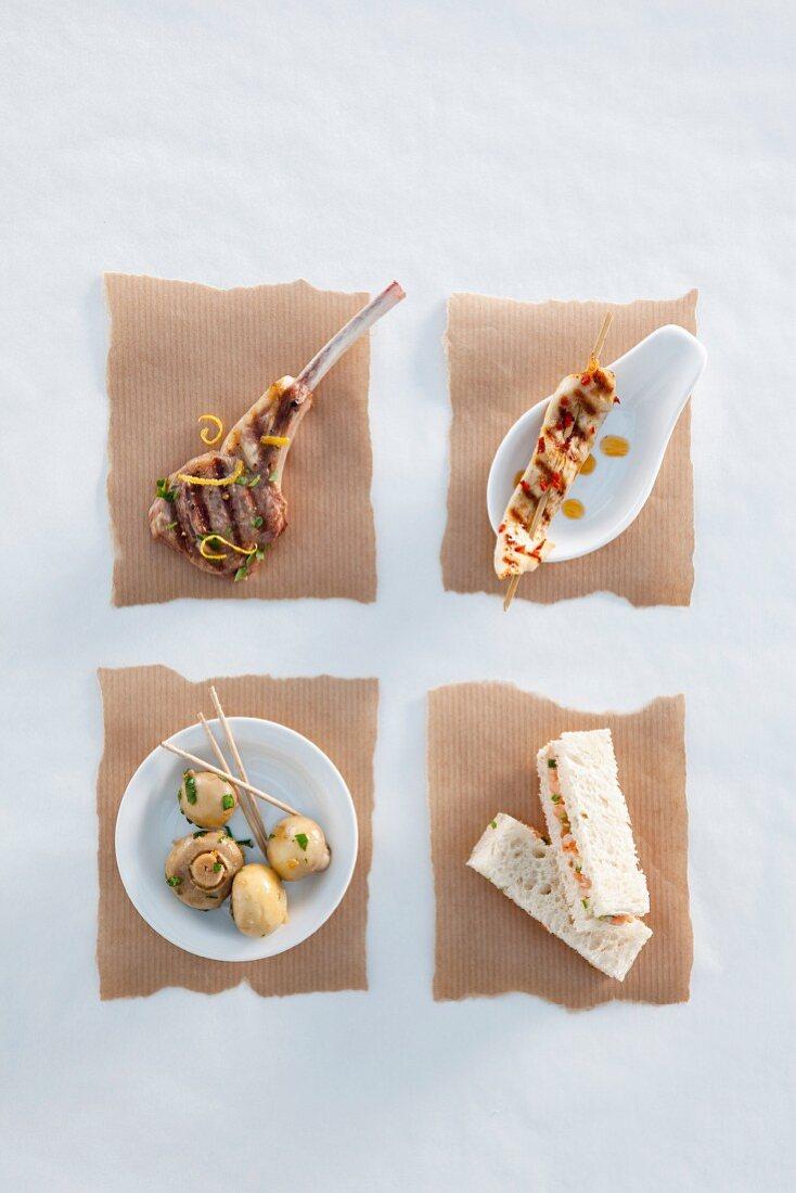 A lamb chop, chicken breast, mushrooms and a salmon sandwich