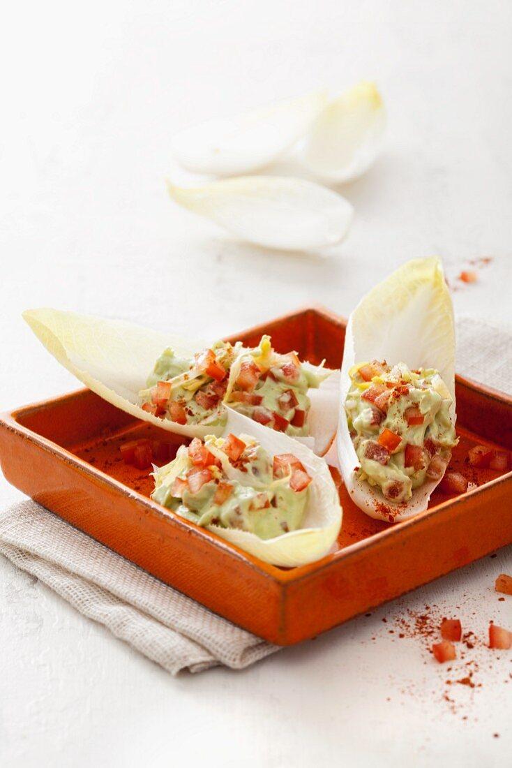 Chicory boats with avocado and tomato cream