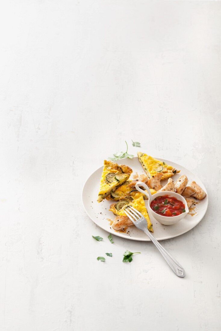 Courgette frittata with turkey breast and tomato sauce