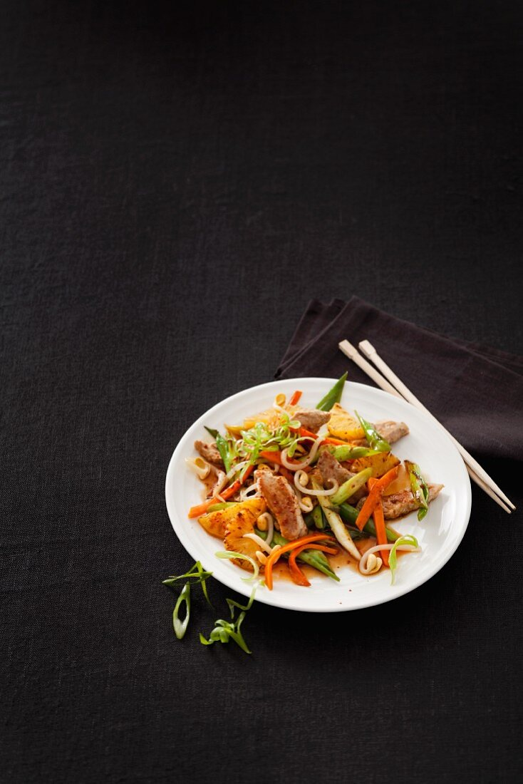 Stir-fried pork fillet with pineapple, carrots, spring onions and mungo bean sprouts