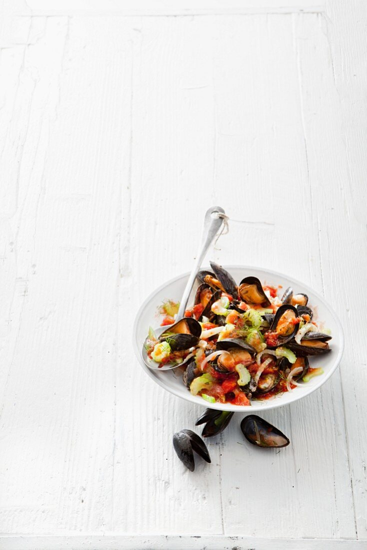 Mussels in a wine broth with celery and tomatoes