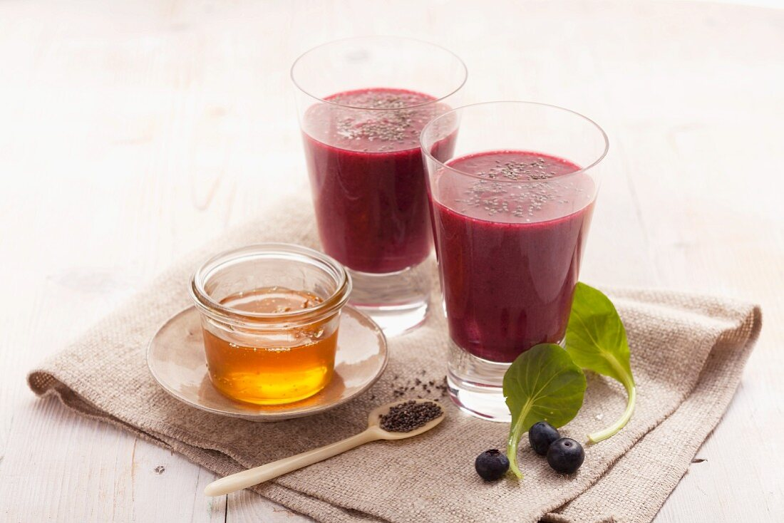 A blueberry smoothie with cranberries, tatsoi, stinging nettels, chia seeds and honey