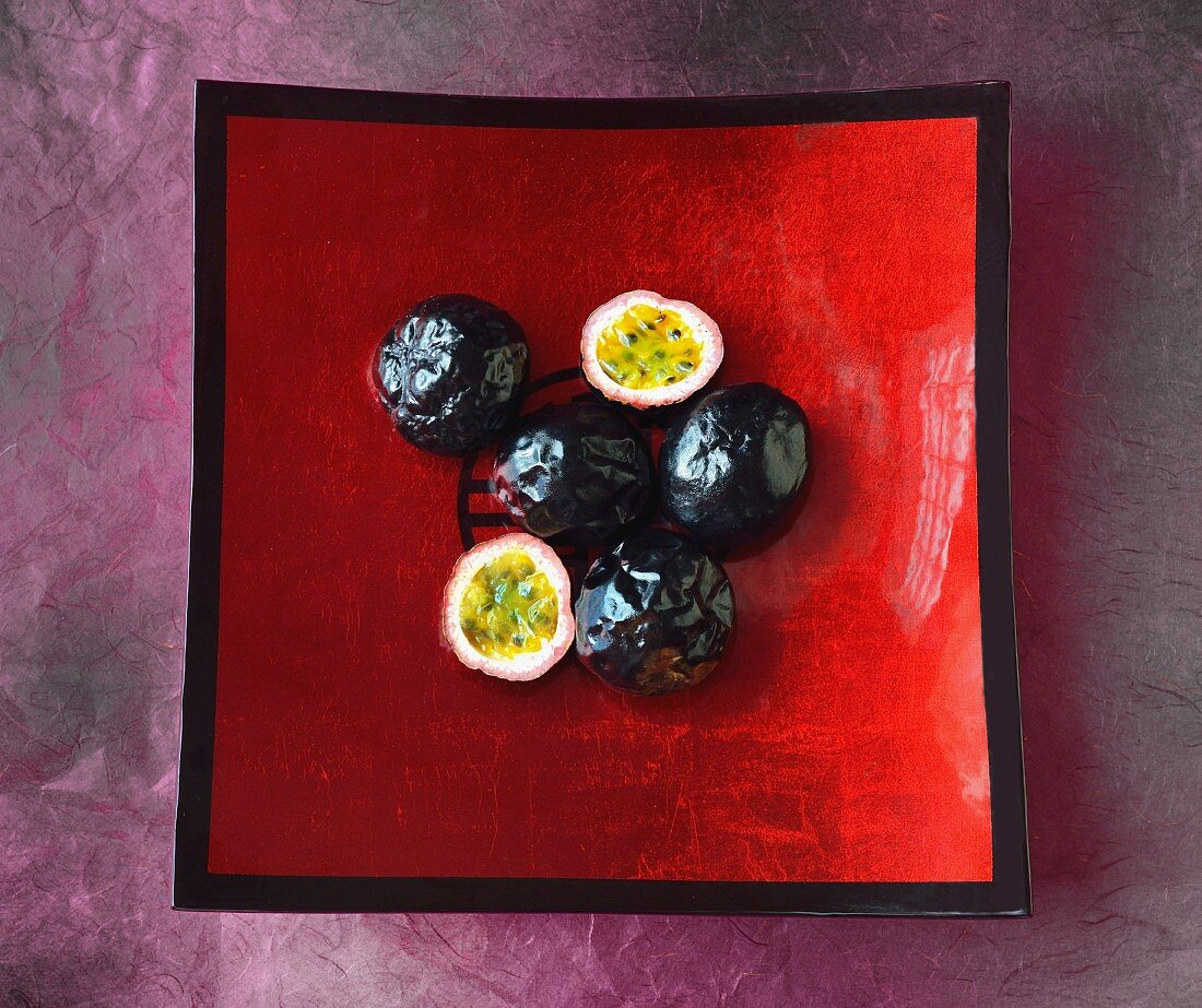 Passion fruits in a red fruit bowl