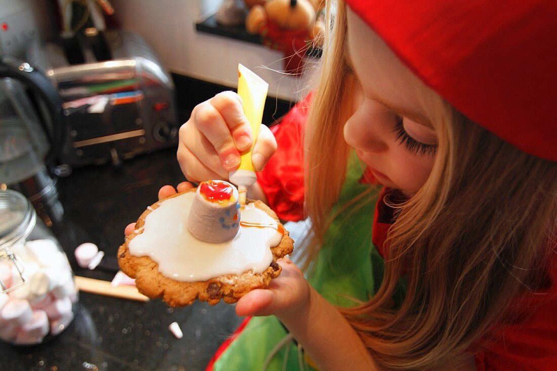 Girl decorating Christmas biscuits