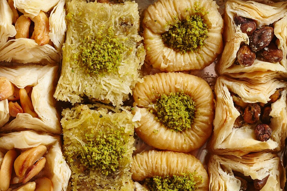 Various types of baklava on a porcelain plate