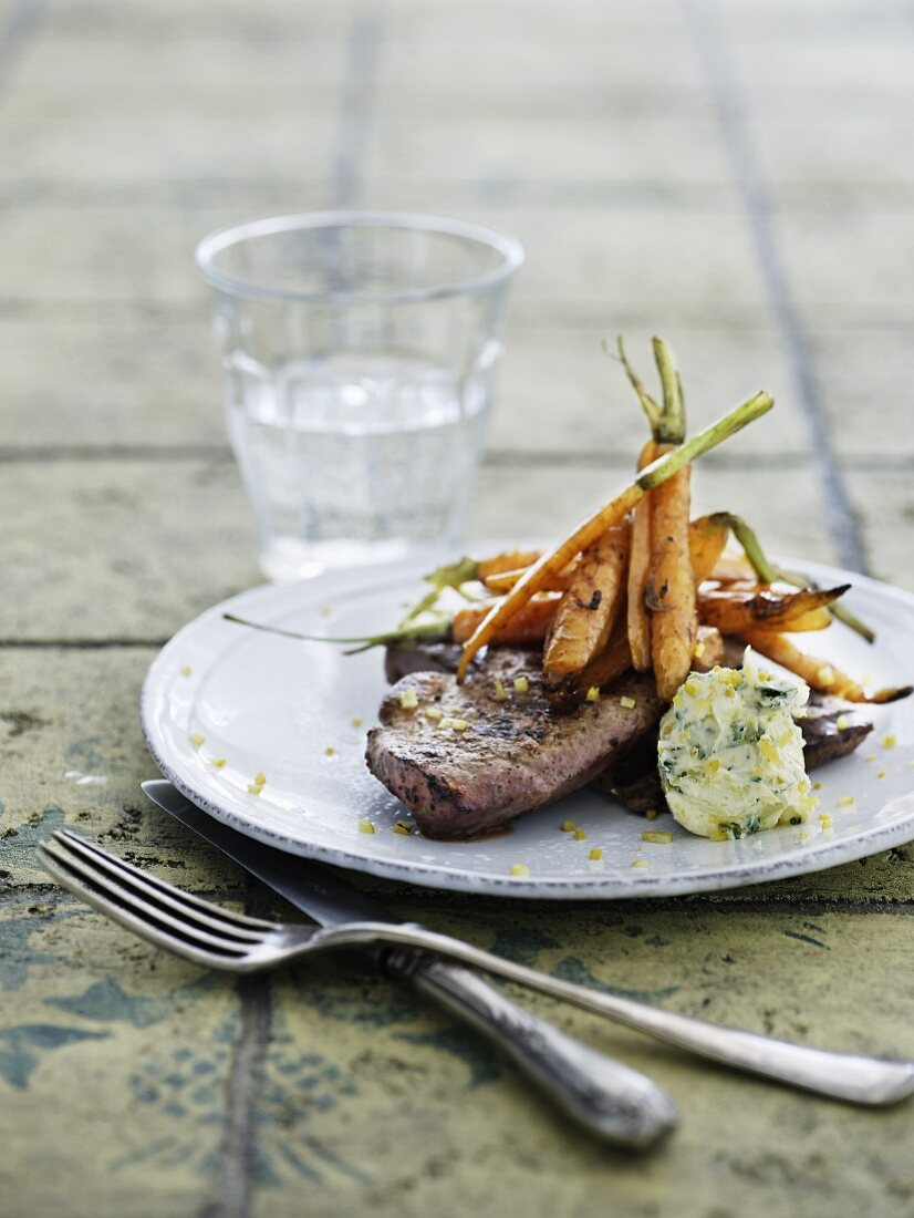 Grilled veal liver with braised carrots and lemon parsley butter