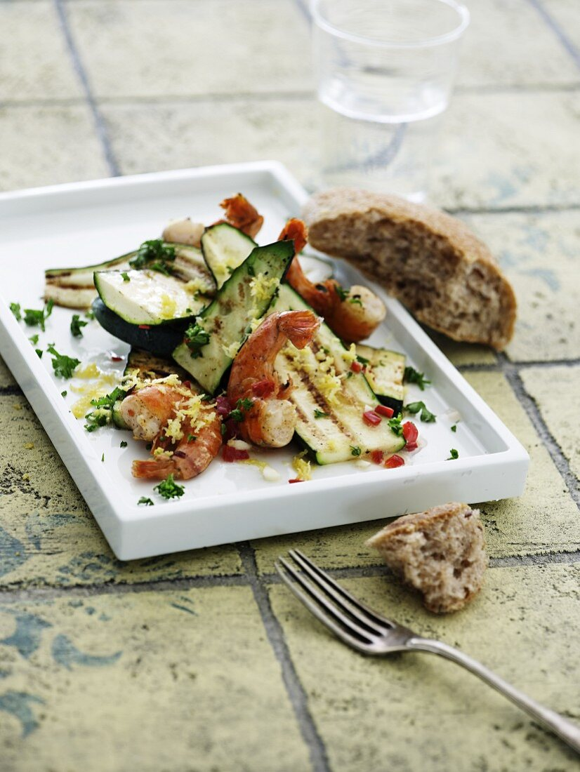 Grilled prawns and courgette with lemons, parsley and chilli
