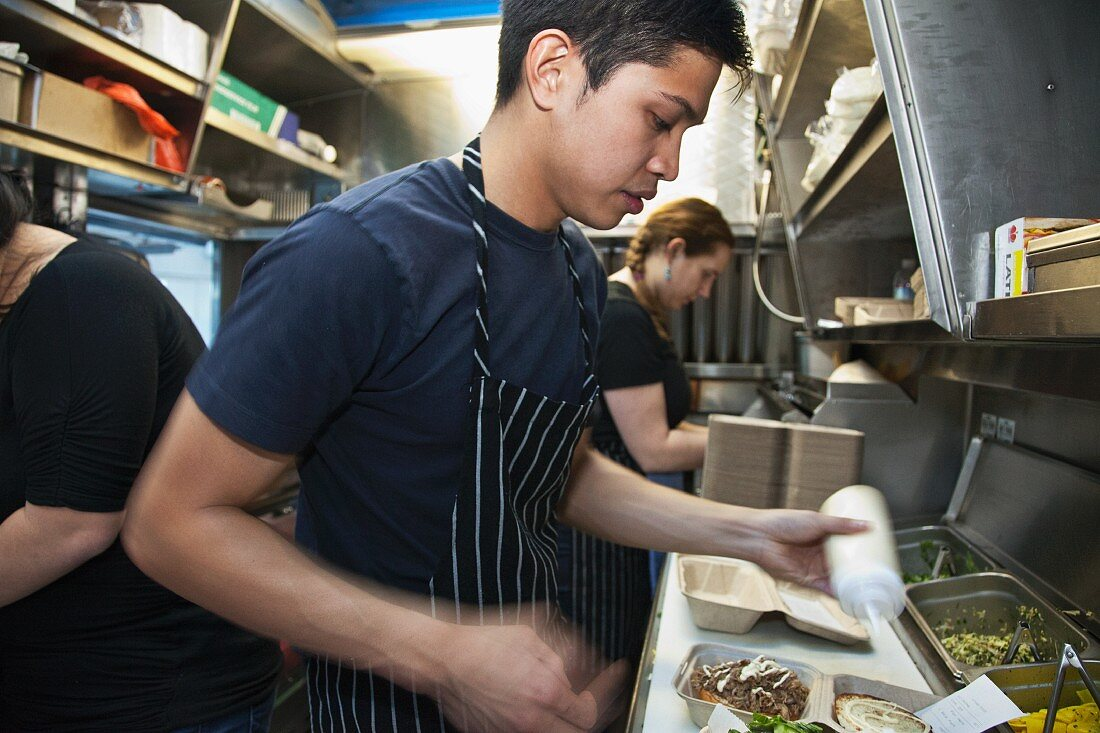 Chefs working in a food truck (USA)