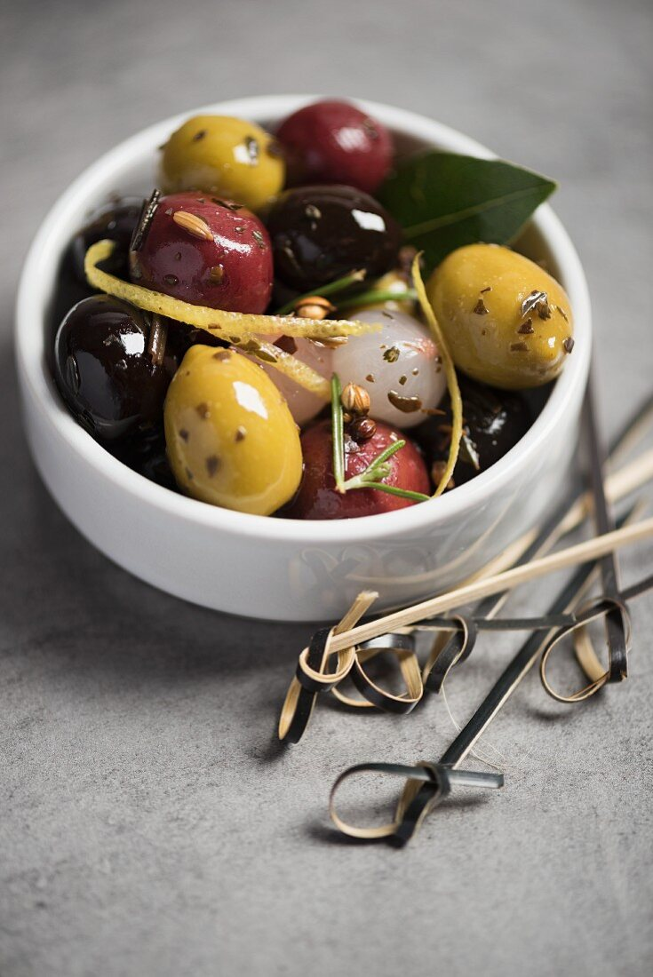 Olives and pearl onions with herbs in a red wine vinegar and olive oil vinaigrette
