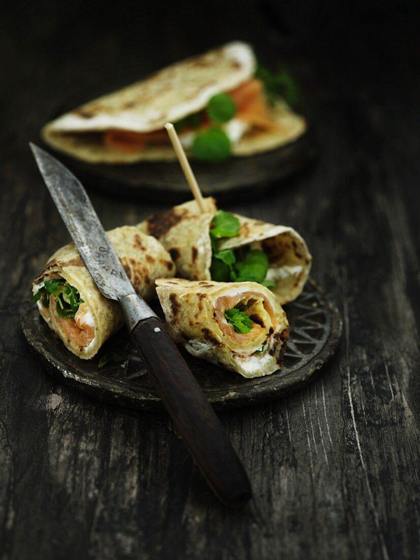 Pancake rolls with smoked salmon, horseradish and herbs