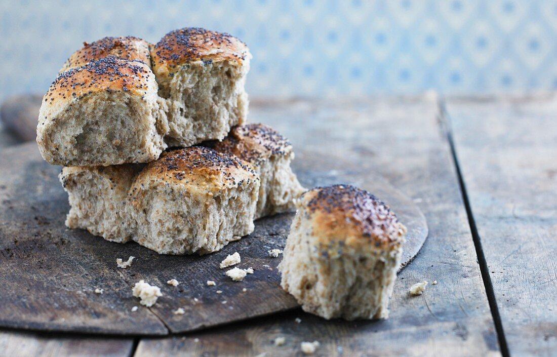 Poppy seed bread rolls on a wooden board