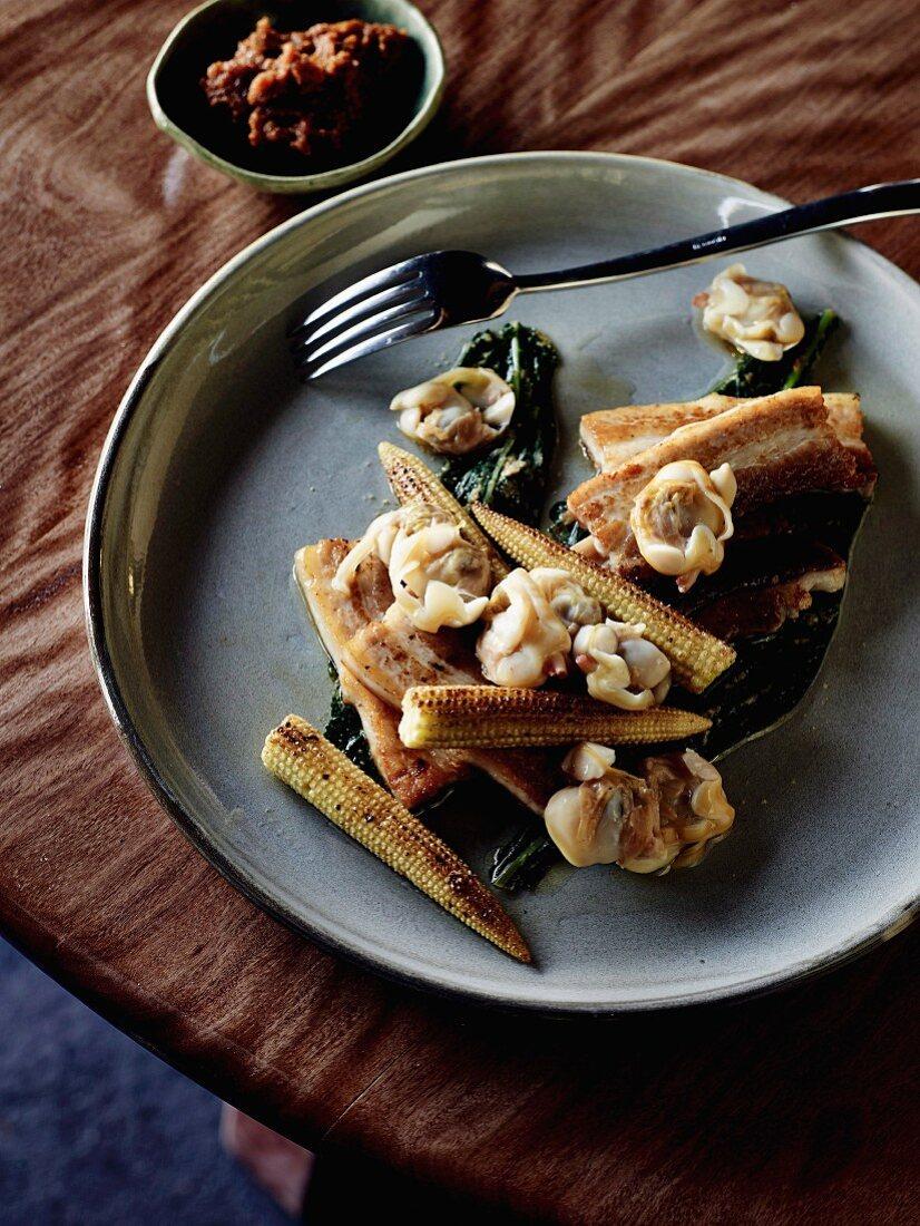 Pork belly with clams, cavolo nero namul and corn