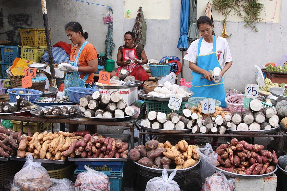 Taro and yam sellers at a market, Thailand