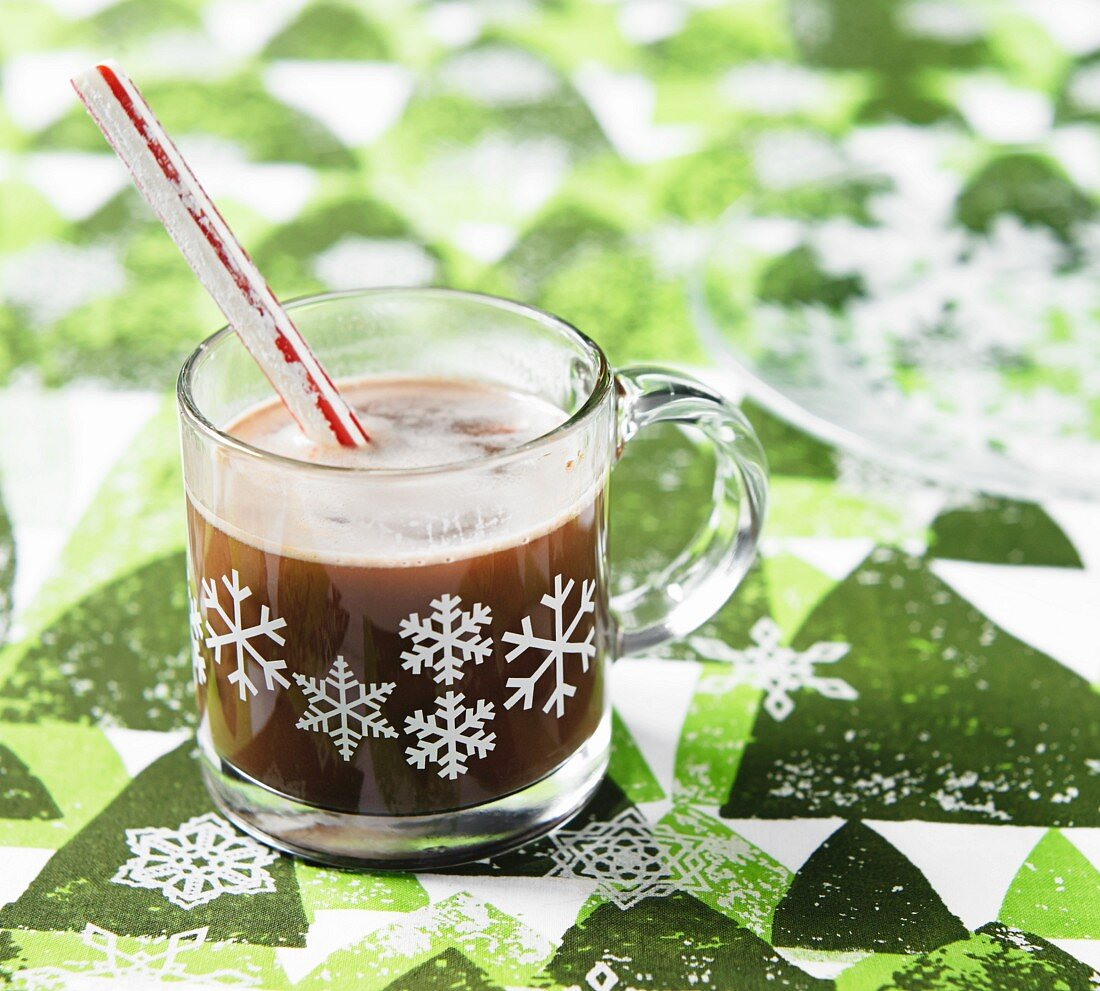 Hot chocolate with a stick of peppermint rock