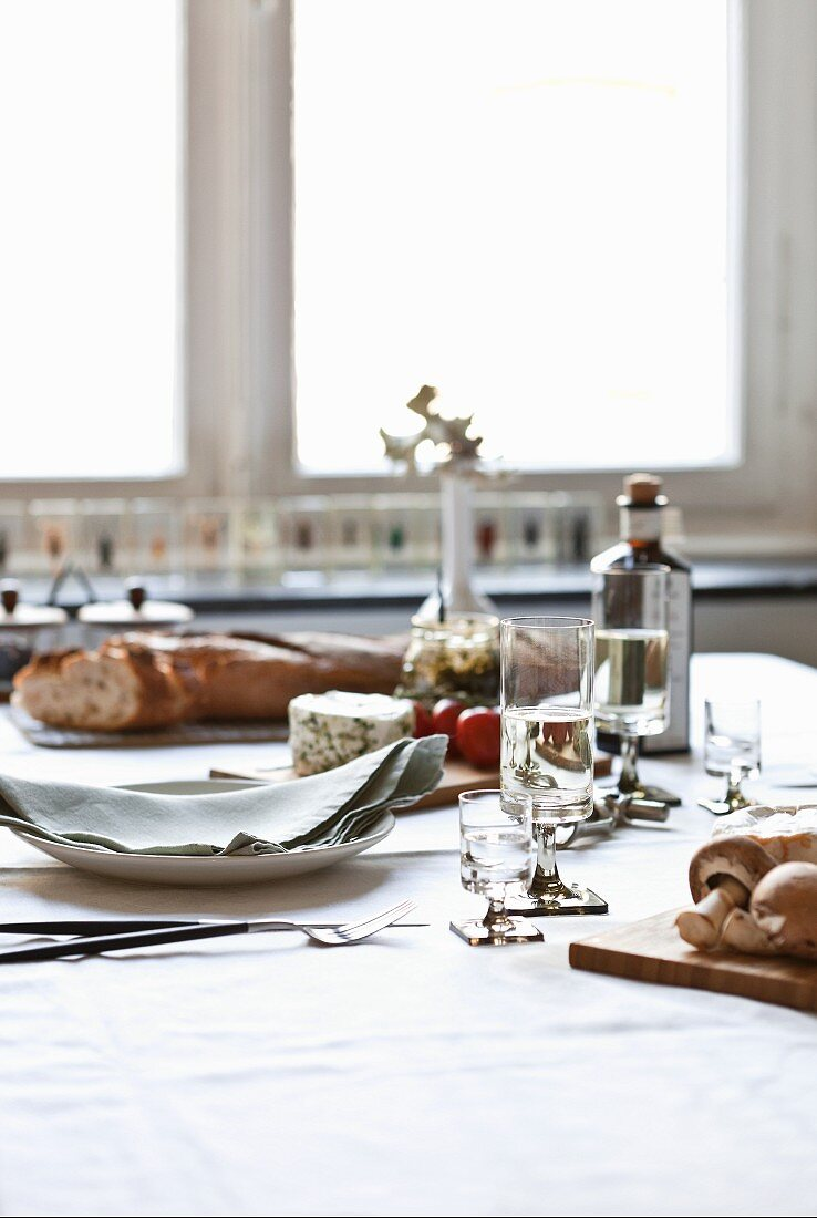 Table set with bread and cheese