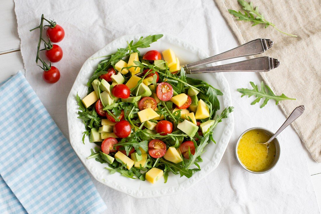 Avocado and mango salad with rocket and cherry tomatoes