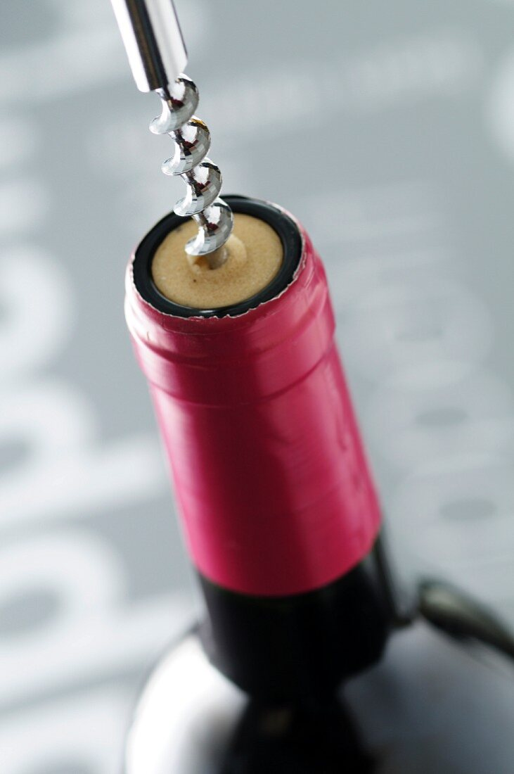 Uncorking a bottle of red wine
