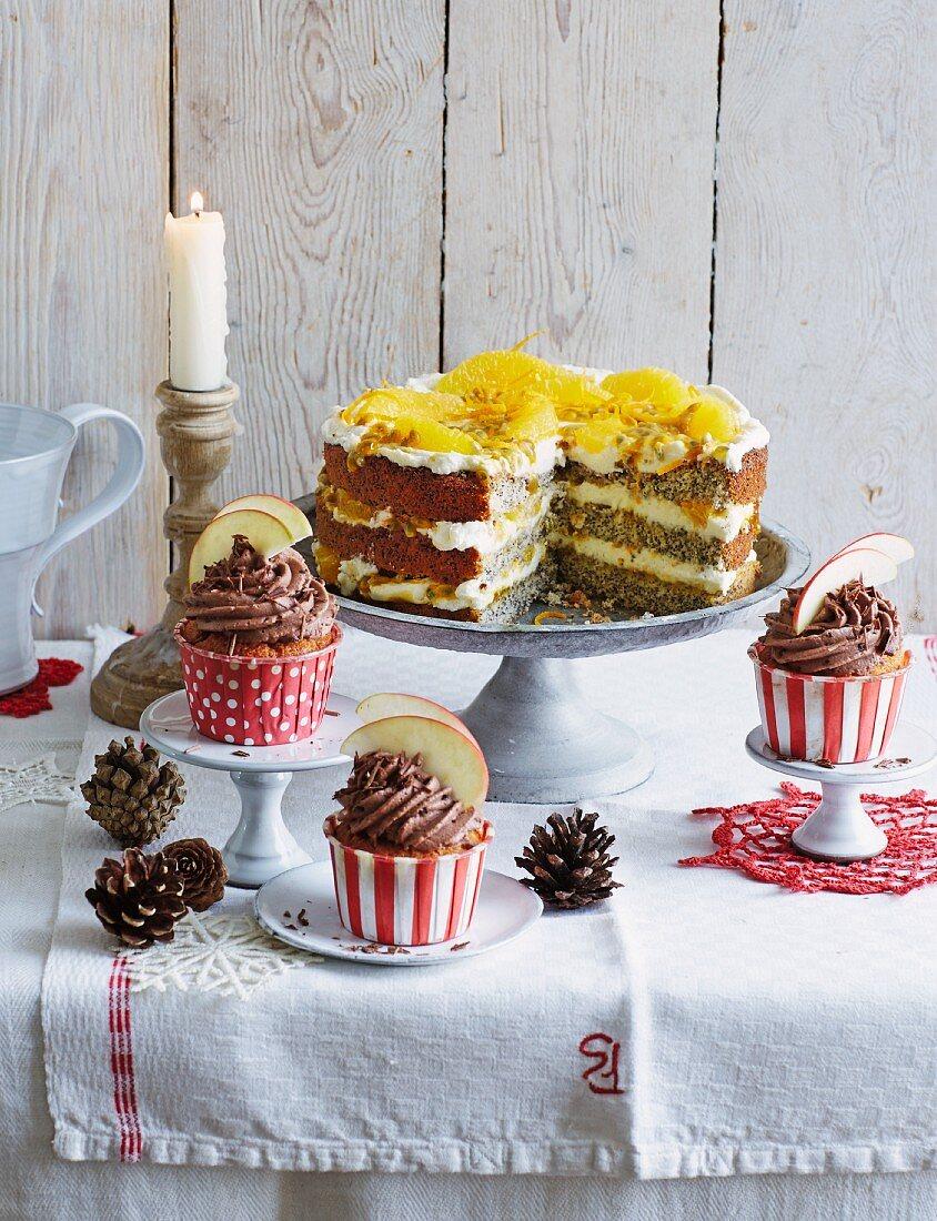 Baked apple cupcakes and orange and poppyseed cake, sliced (Christmas)