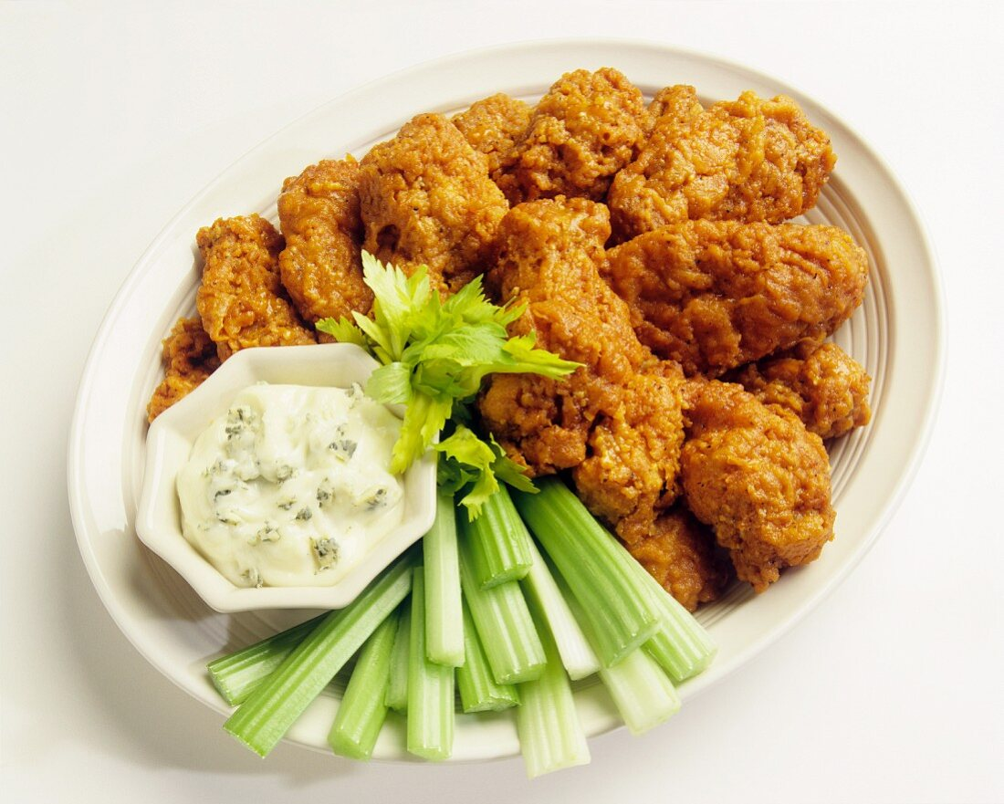Buffalo chicken wings with celery and a blue cheese dip