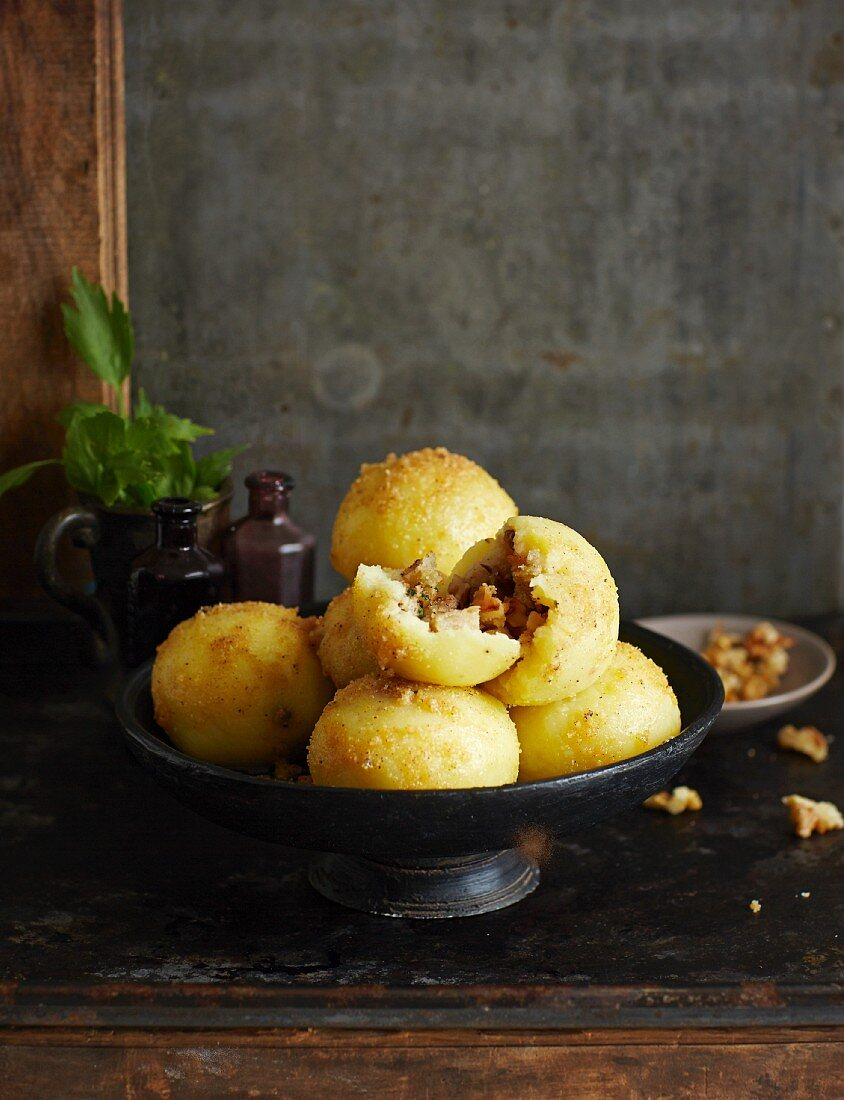 Potato dumplings filled with bread and buttered crumbs