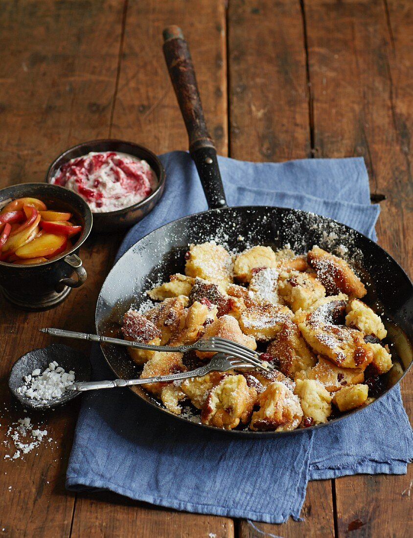 Shredded pancakes with apples and lingonberry cream