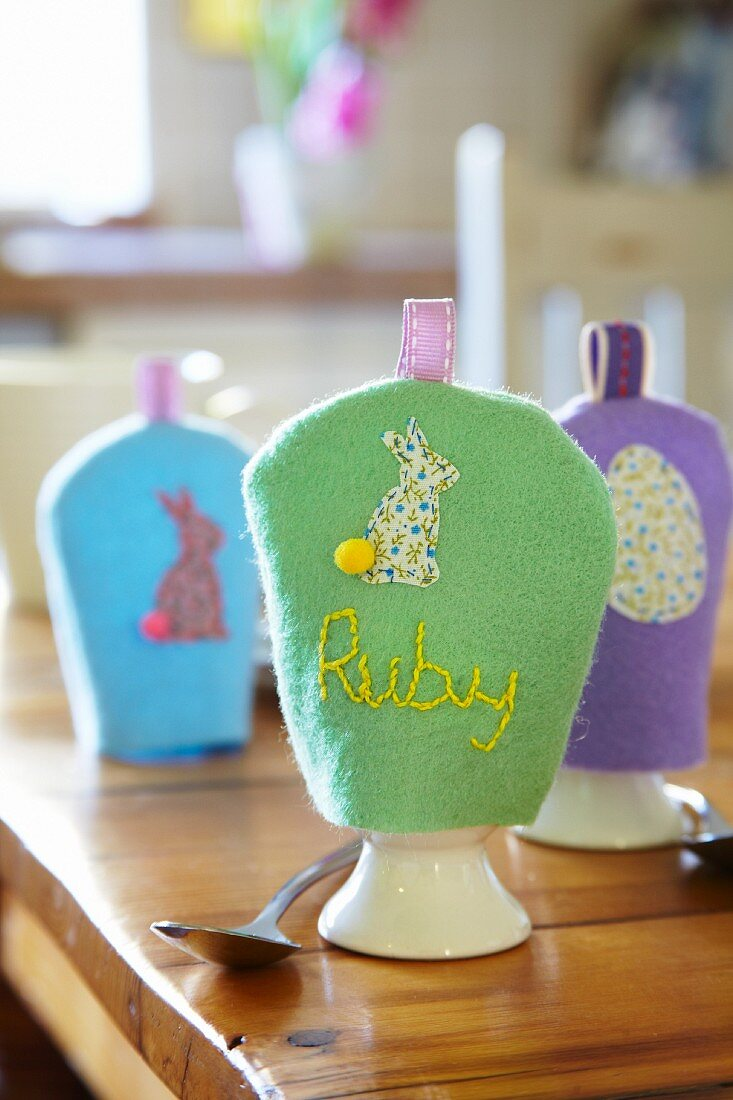 Hand-crafted felt egg cosies for Easter