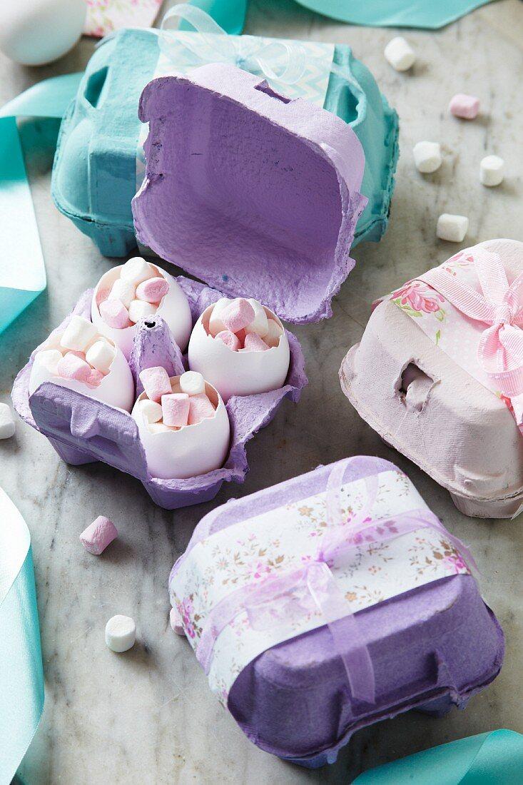 Eggshells full of mini marshmallows in decorative egg boxes