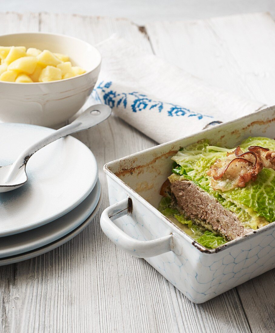 Lamb meatloaf wrapped in savoy cabbage
