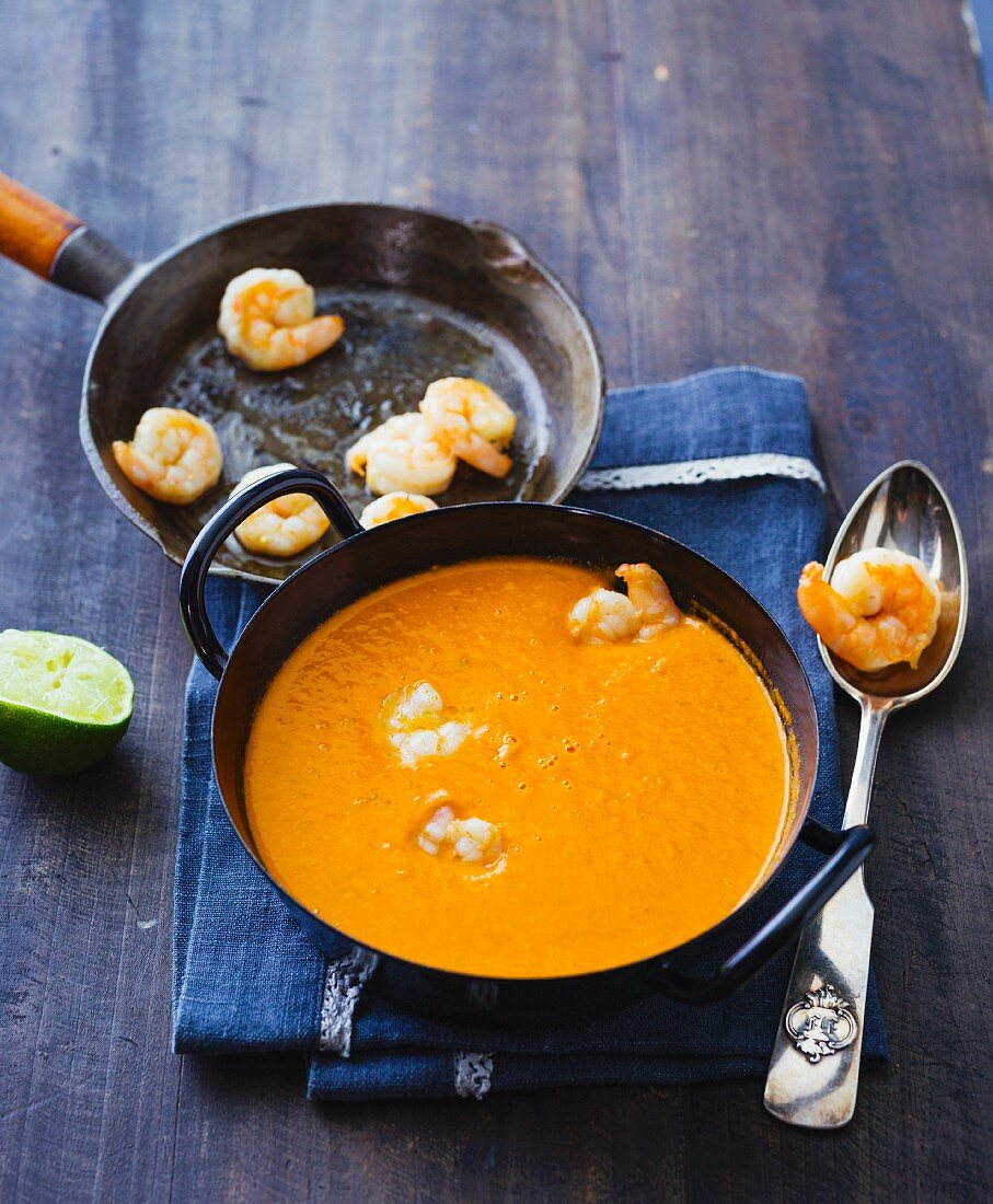 Tomato and coconut soup with fried prawns and ginger
