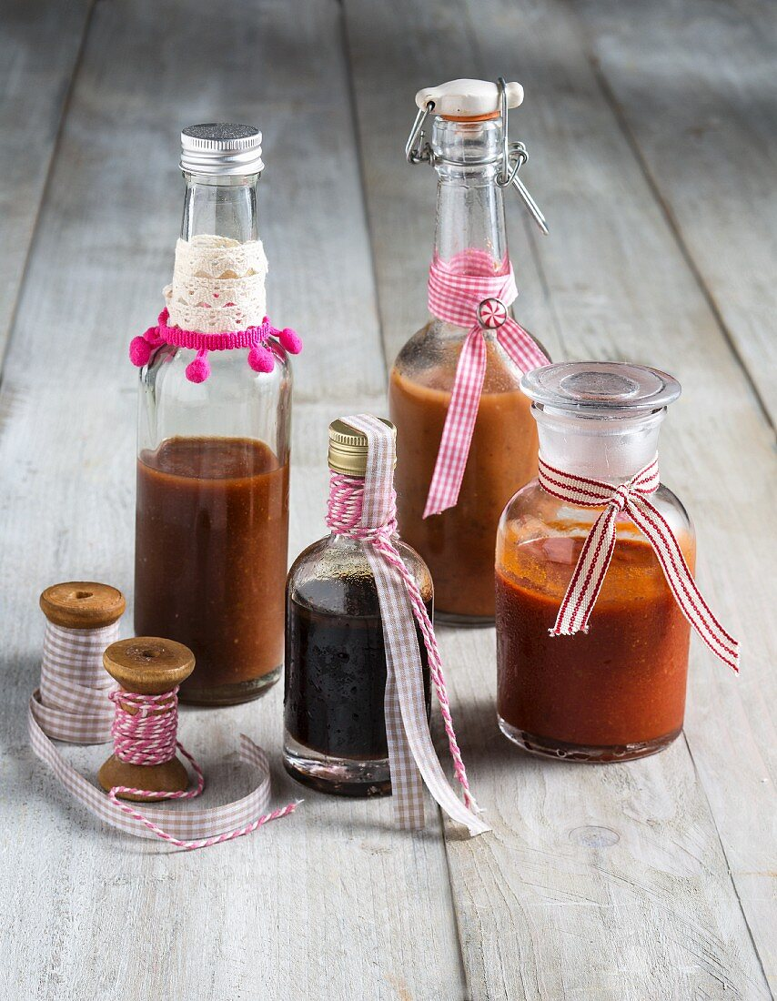 Ribbons decorating gifts of homemade sauces