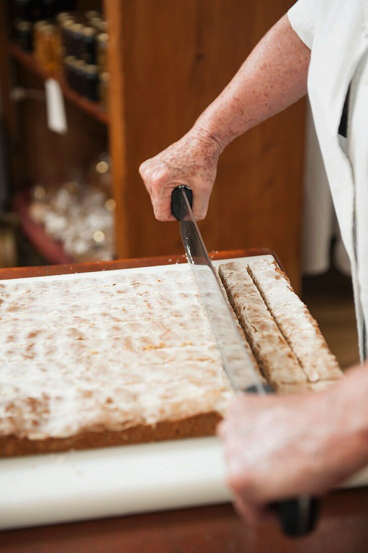 Spiced bread being sliced, 'Pain d'Épices' de Mireille Oster, Strasbourg
