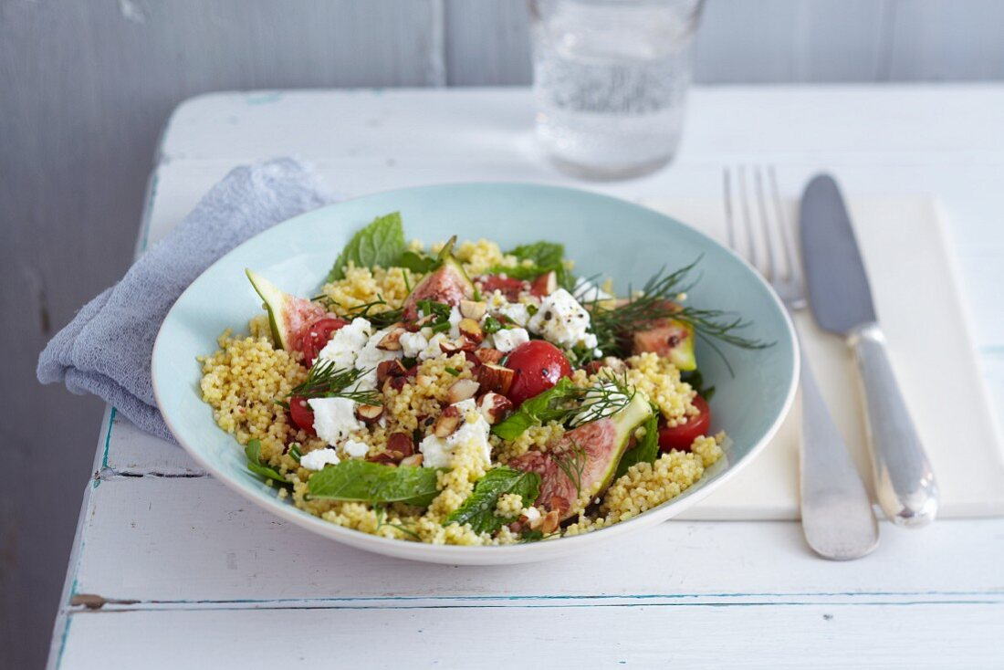 Millet and herb salad with fresh figs, sheep's cheese and almonds