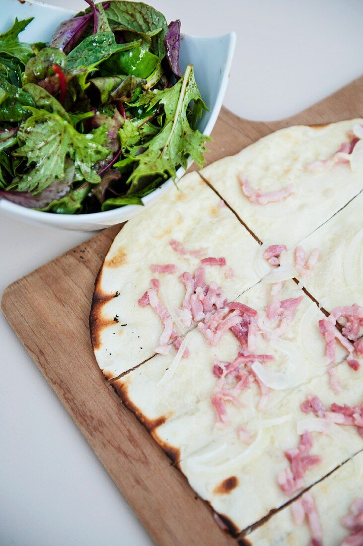 Tarte flambée with a side salad (Alsace speciality)