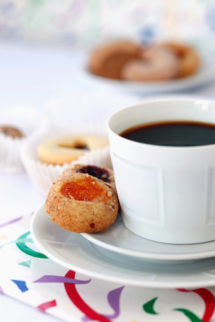 A cup of coffee with pastries