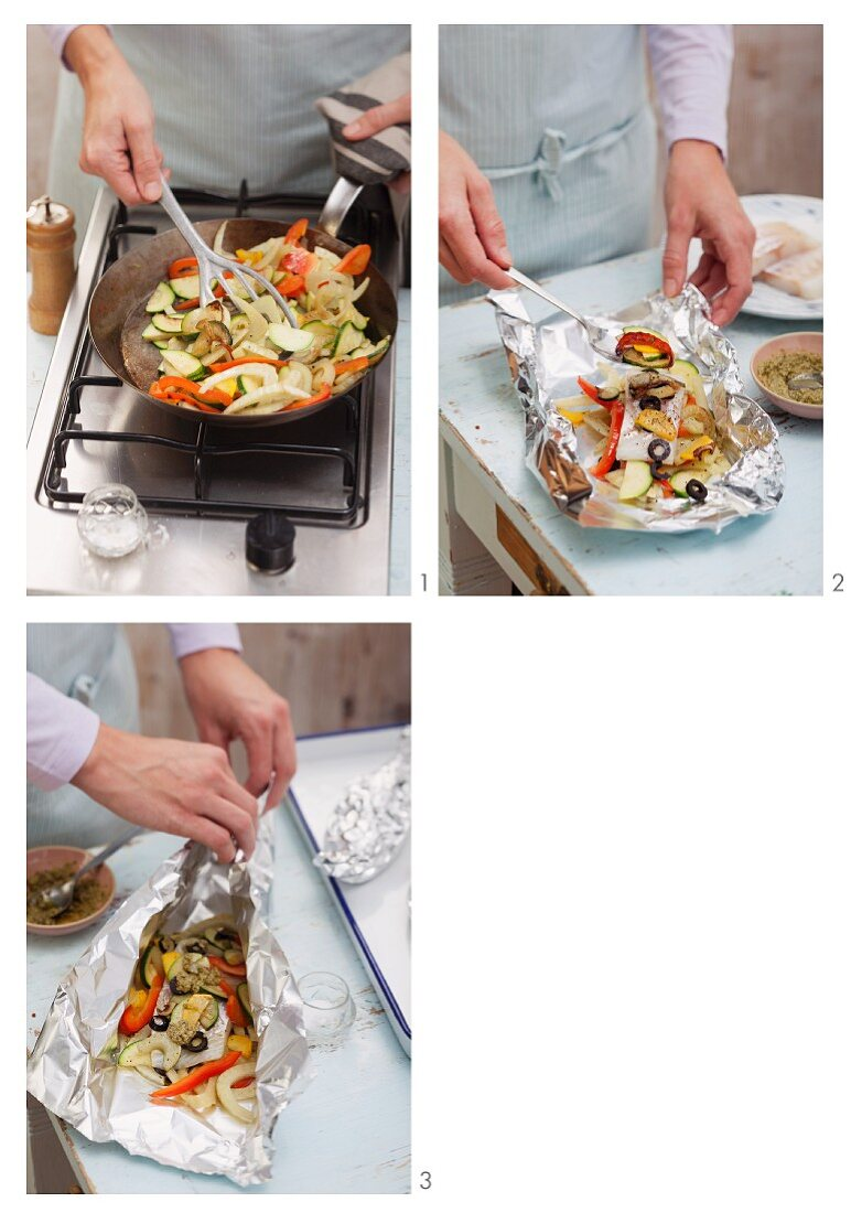 Steamed fish fillet with Mediterranean vegetables in aluminium foil being prepared